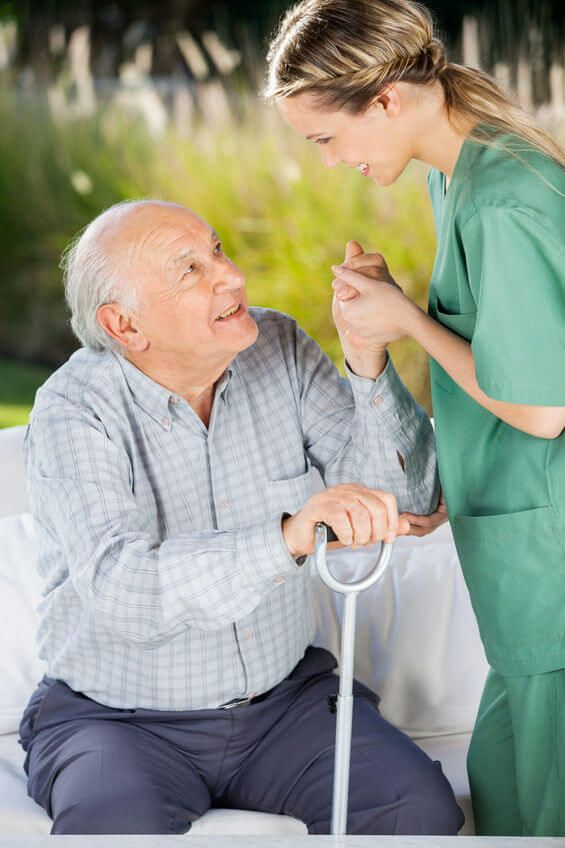 a nurse helping old person